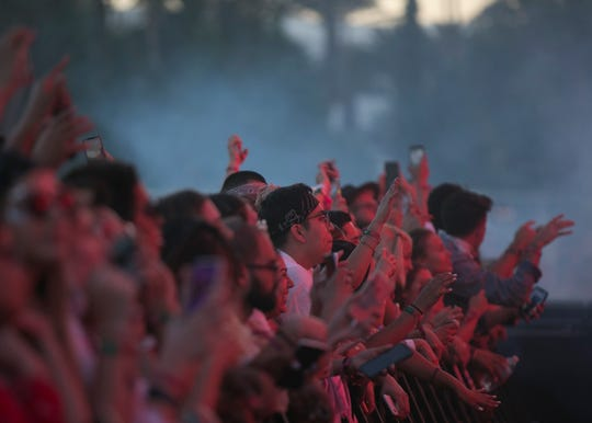 Festivalgoers dance to Zedd performing on the main stage at the Coachella Valley Music and Arts Festival in Indio, Calif. on Sun. April 21, 2019.