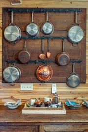 Pans line a wall in the kitchen at Terra Farm + Manor in Prescott National Forest.