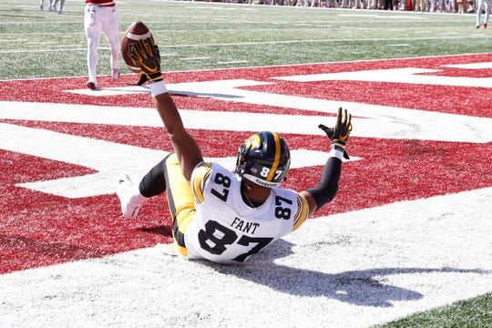 Iowa tight end Noah Fant catches a pass for a touchdown during a game against Indiana.