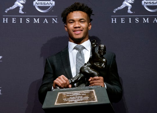 FILE - In this Dec. 8, 2018, file photo, Oklahoma quarterback Kyler Murray holds the Heisman Trophy after winning the award in New York. Murray is a prospect in the 2019 NFL Draft. (AP Photo/Craig Ruttle, File)
