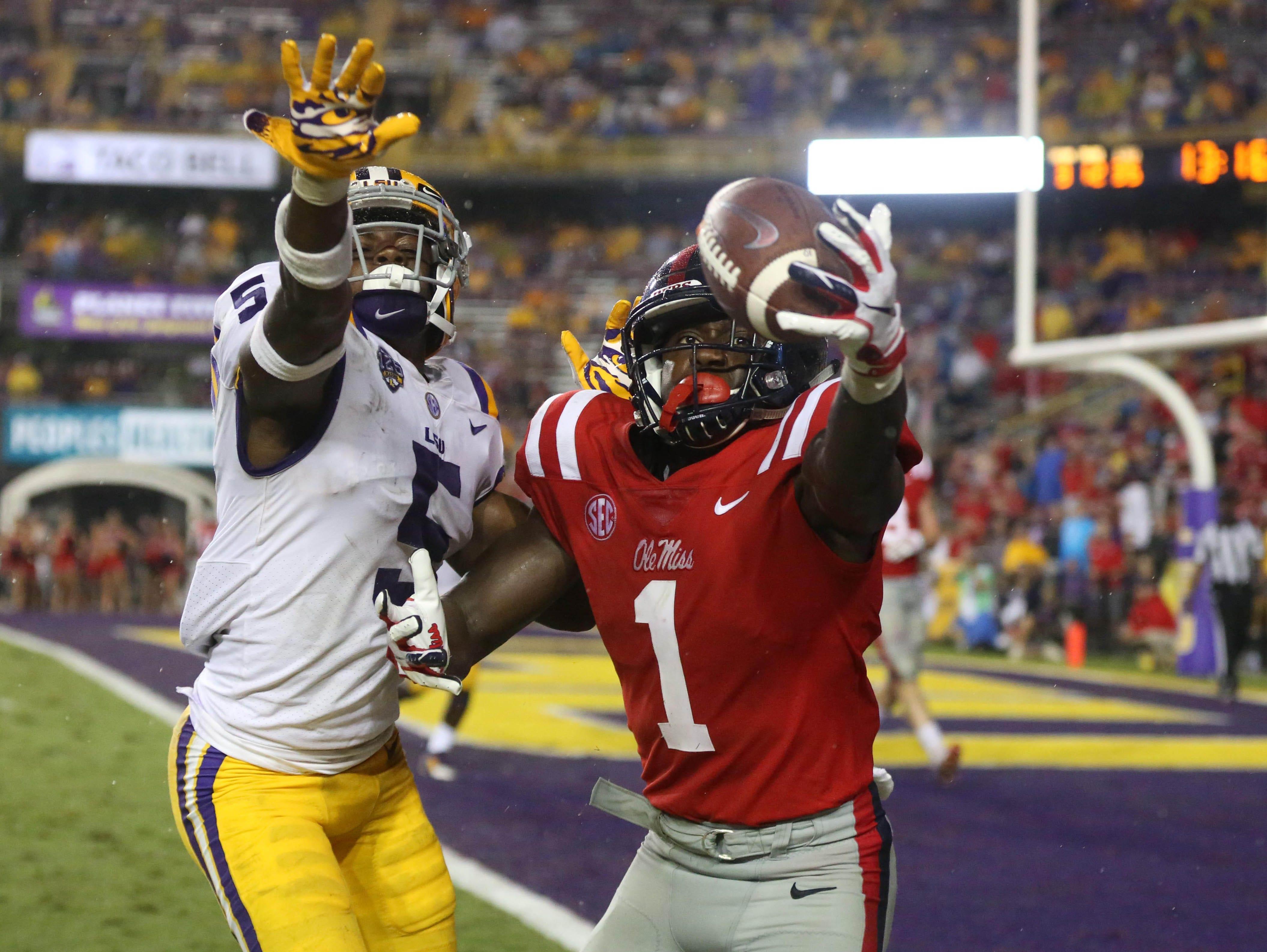 Mississippi receiver A.J. Brown (1) is defended by LSU cornerback Kary Vincent Jr. (5) during a game at Tiger Stadium.
