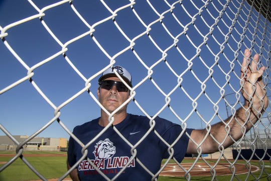 Sierra Linda High School baseball coach Jacob Ciesielczyk stands on the field the players helped build.