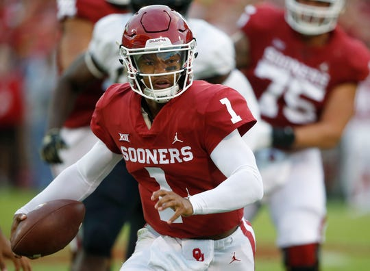 FILE - In this Sept. 22, 2018, file photo, Oklahoma quarterback Kyler Murray (1) carries for a touchdown in the first half of an NCAA college football game against Army in Norman, Okla.  Murray and Nick Bosa are among the 23 prospects who plan to attend the NFL draft this month in Nashville, Tenn. Murray, the Heisman Trophy-winning quarterback, could be selected No. 1 overall by the Arizona Cardinals. Bosa, a defensive end from Ohio State, also is expected to be a top-three pick. (AP Photo/Sue Ogrocki, File)