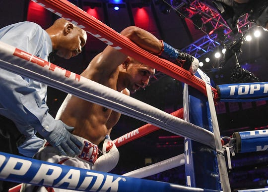 Amir Khan heads to a corner after a hit from Terence Crawford during a WBO welterweight title fight at Madison Square Garden.