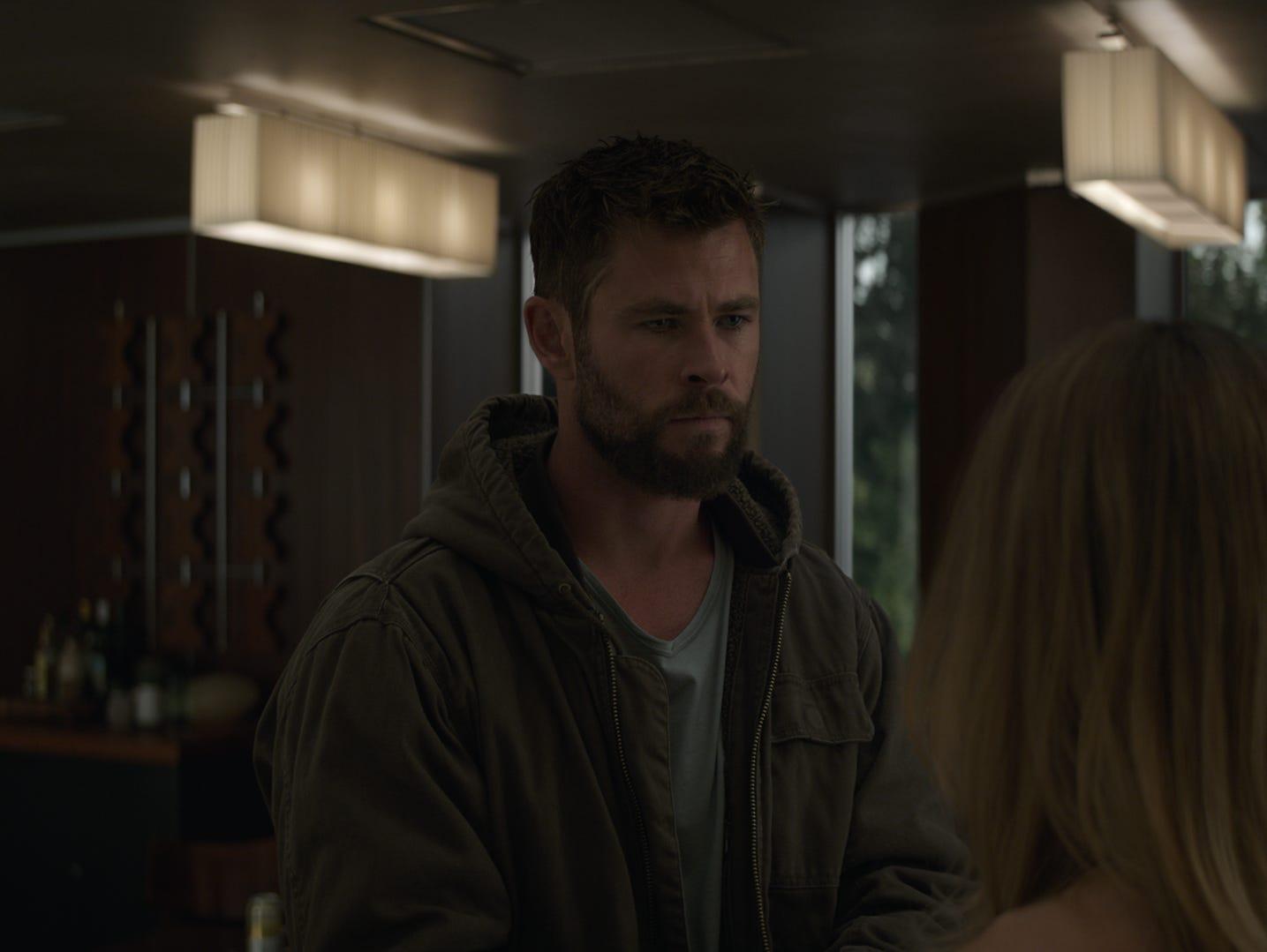 """Thor (Chris Hemsworth) and Captain Marvel (Brie Larson) talk in """"Avengers: Endgame."""""""