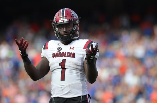 South Carolina receiver Deebo Samuel  gets the crowd pumped up during a game at Ben Hill Griffin Stadium.