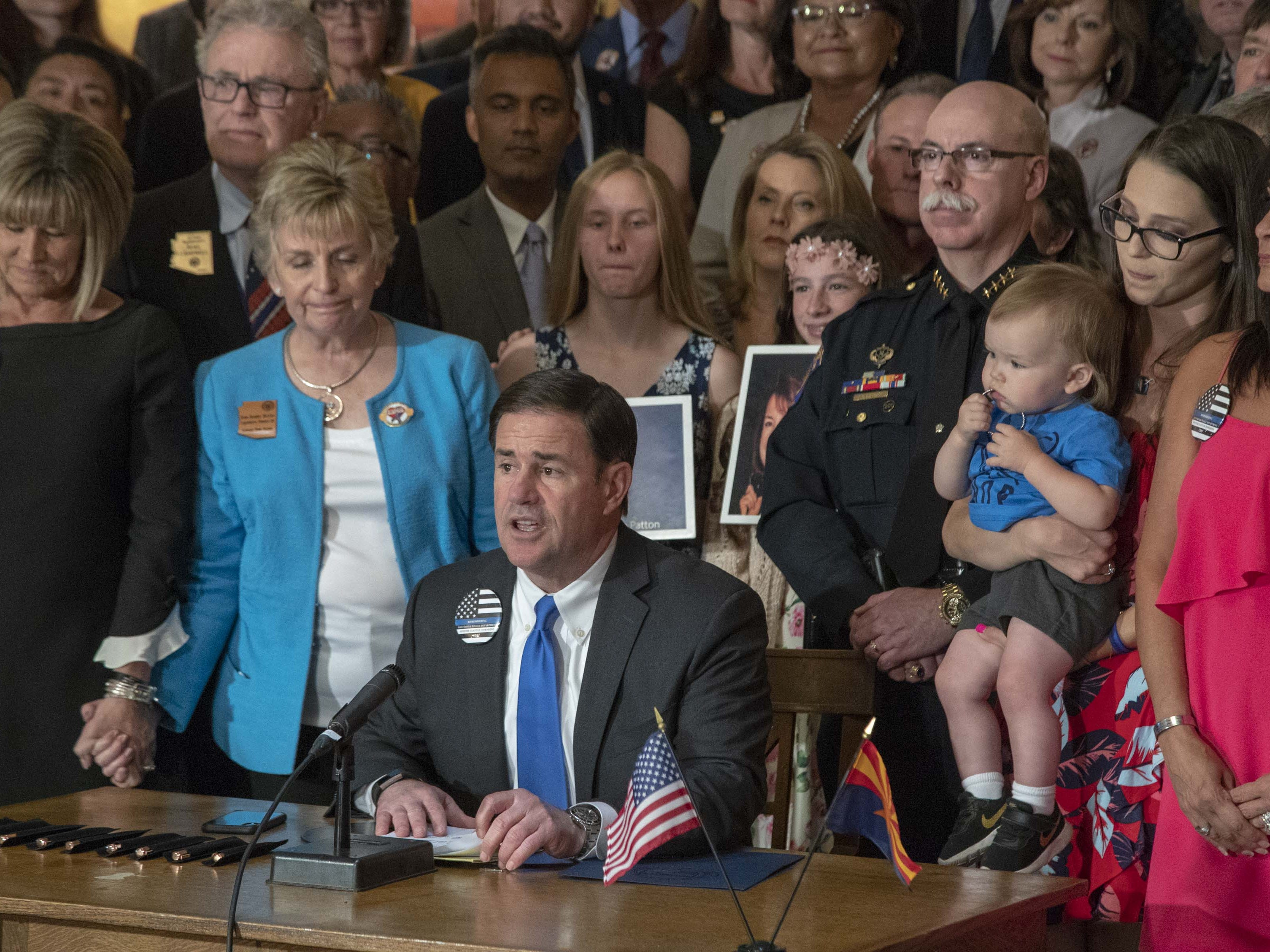 Gov. Doug Ducey sits among advocates, law enforcement and legislators on April 22, 2019, for the signing of HB 2318 in the Rotunda of the Arizona Capitol Museum. This bill prohibits texting while driving.