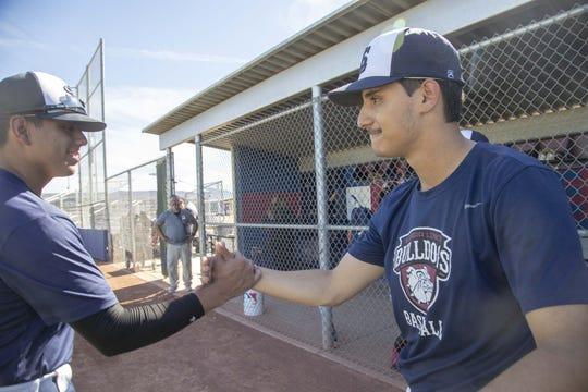 Julian Garcia, on left and Anthony Orton on right, both seniors at Sierra Linda High School baseball team.