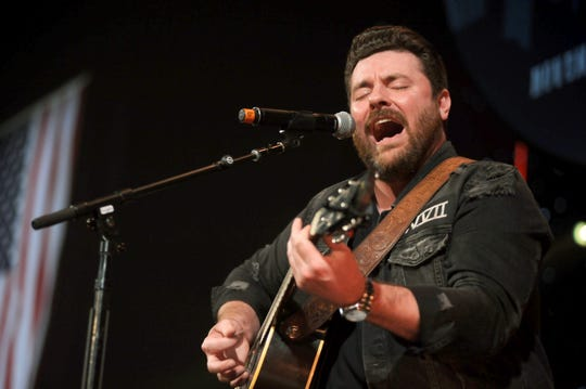 Chris Young performs during CBS RADIO's Third Annual 'Stars and Strings' Concert to honor our nation's veterans at Chicago Theatre on November 15, 2017 in Chicago.