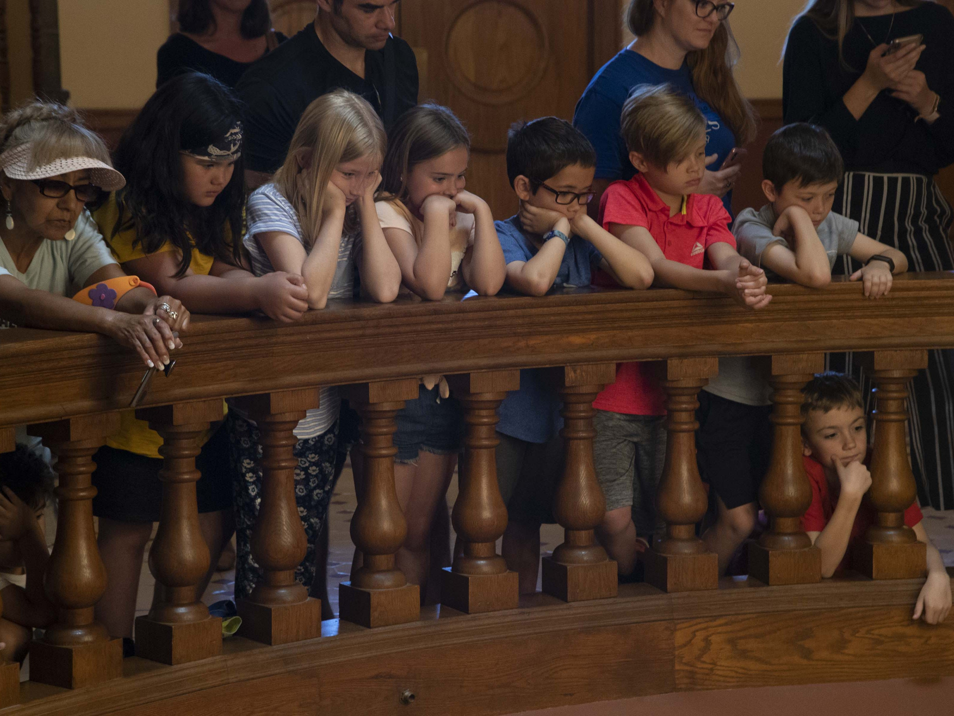 Spectators watch while Gov. Doug Ducey signs a bill that prohibits texting while driving on April 22, 2019.