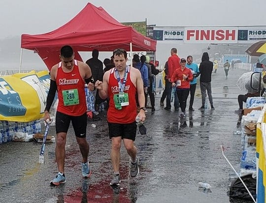 Marist alums Omar Perez and Billy Posch are shown crossing the finish line in the Newport Rhode Race Marathon. The men have earned a spot in the 2020 Boston Marathon.