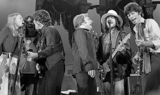"""Left to right, Joni Mitchell, Neil Young, Rick Danko, Van Morrison, Bob Dylan and Robbie Robertson perform a number with The Band during their last concert on Thanksgiving Day, Nov. 25, 1976, at the Winterland Ballroom in San Francisco, Calif. """"The Last Waltz"""" (1978), The Band's farewell concertfilmed by Martin Scorsese, will be shown on the big screen at UPAC in Kingston, April 26."""