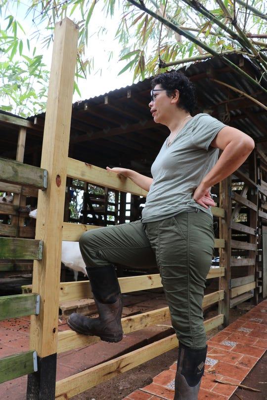 Sarah Ratliff checks on livestock at the farm.