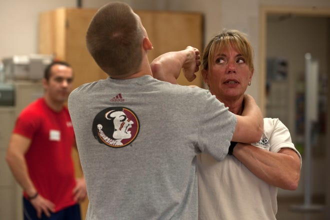 Kathy Wright, director of women's programs for R.A.D. Systems, teaches airmen defensive techniques during a R.A.D. Systems class Sept. 18, 2012, at Nellis Air Force Base, Nevada.