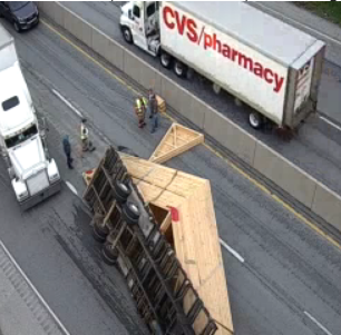 Overturned tractor-trailer shuts down northbound lanes on I-83 Monday morning