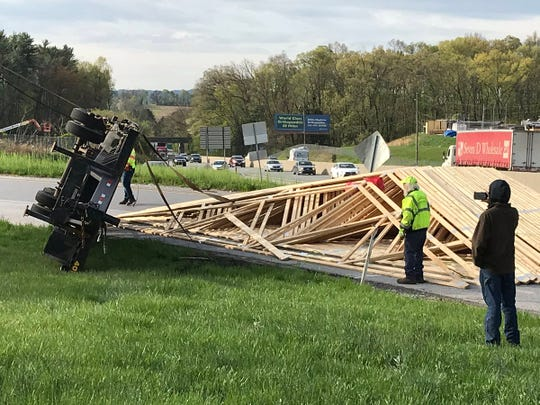 A flatbed truck carrying this load of building supplies crashes on the on-ramp to Interstate 83 North at Exit 24 in Manchester Township.