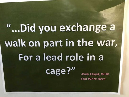 "This quote from Pink Floyd's ""Wish You Were Here"" adorns Steve Barndt's office door."