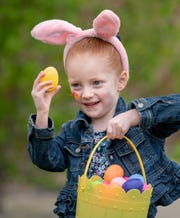 Noelle Martin, 4, of Fernley, shows off her basket of eggs at Crosswinds Church.