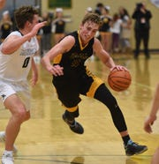 Moses Wood drives to the basket against Manogue's Brayden De Bruin on Jan. 16, 2018.
