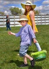 Ryan Flakus, 5, of Yerington, swings his basket while hunting for eggs.