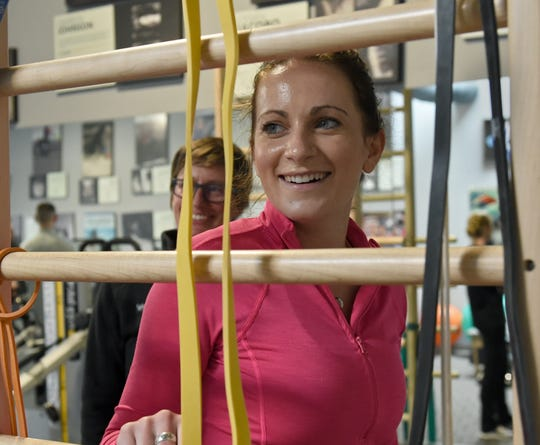 Kelly Cass smiles with the therapists as she goes through her physical therapy at Spine Nevada. She was hit by a drunk driver as she rode her skateboard near her Sacramento home in December of 2018. At the time doctors doubted she would ever walk again.