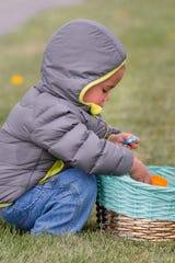 Huxley Ramirez, 2, of Fernley, takes candy from eggs he found at Living Stones Church.