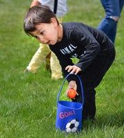 Romijo Conchola, 4, of Yerington, drops an egg into his basket.