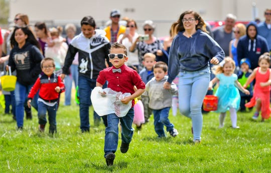 Kids race to find Easter eggs at the start of the hunt.
