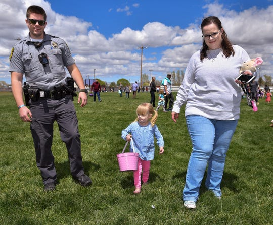 Madi Almaraz, 3, of Yerington, hunts for eggs with her parents, Bryan and Haley.