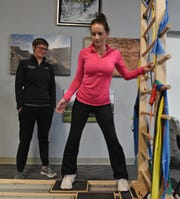 Kelly Cass goes through physical therapy at Spine Nevada. She was hit by a drunk driver as she rode her skateboard near her Sacramento home in December of 2018. At the time doctors doubted she would ever walk again.