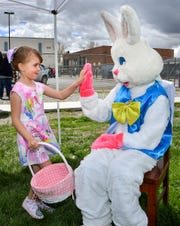 Hannah Stockton, 5, of Yerington, receives a high-five from the Easter Bunny.
