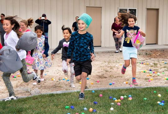 Kids race to gather eggs at the start of the Easter Egg Scramble at Crosswinds Church.