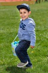 Ivan Sanchez, 3, of Yerington, totes his basket of eggs.
