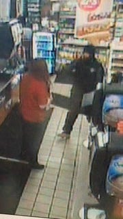 An image taken from surveillance video shows the suspect in the Friday night armed robbery of the Pilot Travel Center at Interstate 70 and U.S. 127.