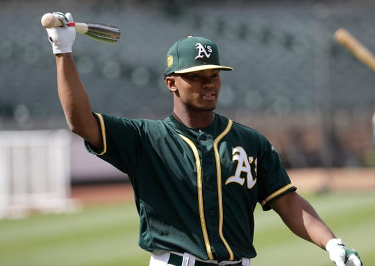 Oakland Athletics draft pick Kyler Murray waits to hit during batting practice before a baseball game between the Athletics and the Los Angeles Angels in Oakland, Calif., Friday, June 15, 2018. (AP Photo/Jeff Chiu)