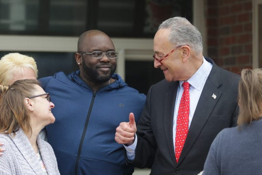 Rob Carter, one of 325 people across New York state who were laid off by Friendly's earlier in April, speaks with Sen. Chuck Schumer in front of a shuttered Friendly's restaurant in Gates on Monday, April 22, 2019.