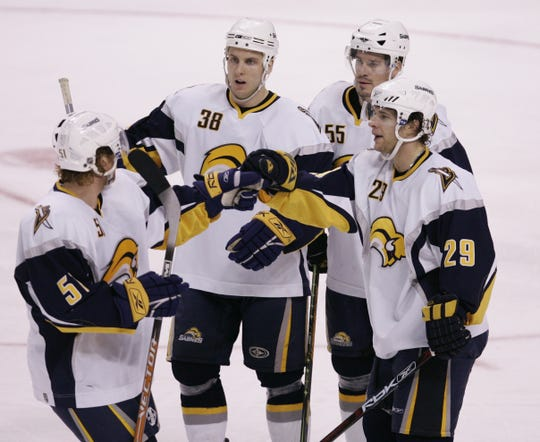 """Buffalo Sabres right wing Jason Pominville, right, celebrates his goal with teammates Brian Campbell (51), Nathan Paetsch (38) and Jochen Hecht (55) during the second period of their hockey game against the Boston Bruins in Boston, Thursday, Nov. 2, 2006. After three seasons in Rochester, Paetsch spent parts of next four years with Buffalo until being traded to Columbus. He would eventually play in Germany before winning two Calder Cups with Grand Rapids. He returned to Amerks in 2017-18 to serve a veteran role. """"It's about winning for the Rochester Americans but it's also about the Buffalo Sabres,'' he said. """"That's why I'm here, I want to help the whole organization, help develop these players.''"""