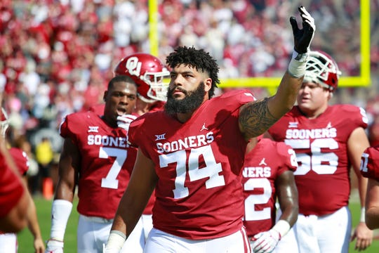 Offensive lineman Cody Ford #74 of the Oklahoma Sooners engages the crowd before the game against the Florida Atlantic Owls at Gaylord Family Oklahoma Memorial Stadium on September 1, 2018 in Norman, Oklahoma. The Sooners defeated the Owls 63-14.
