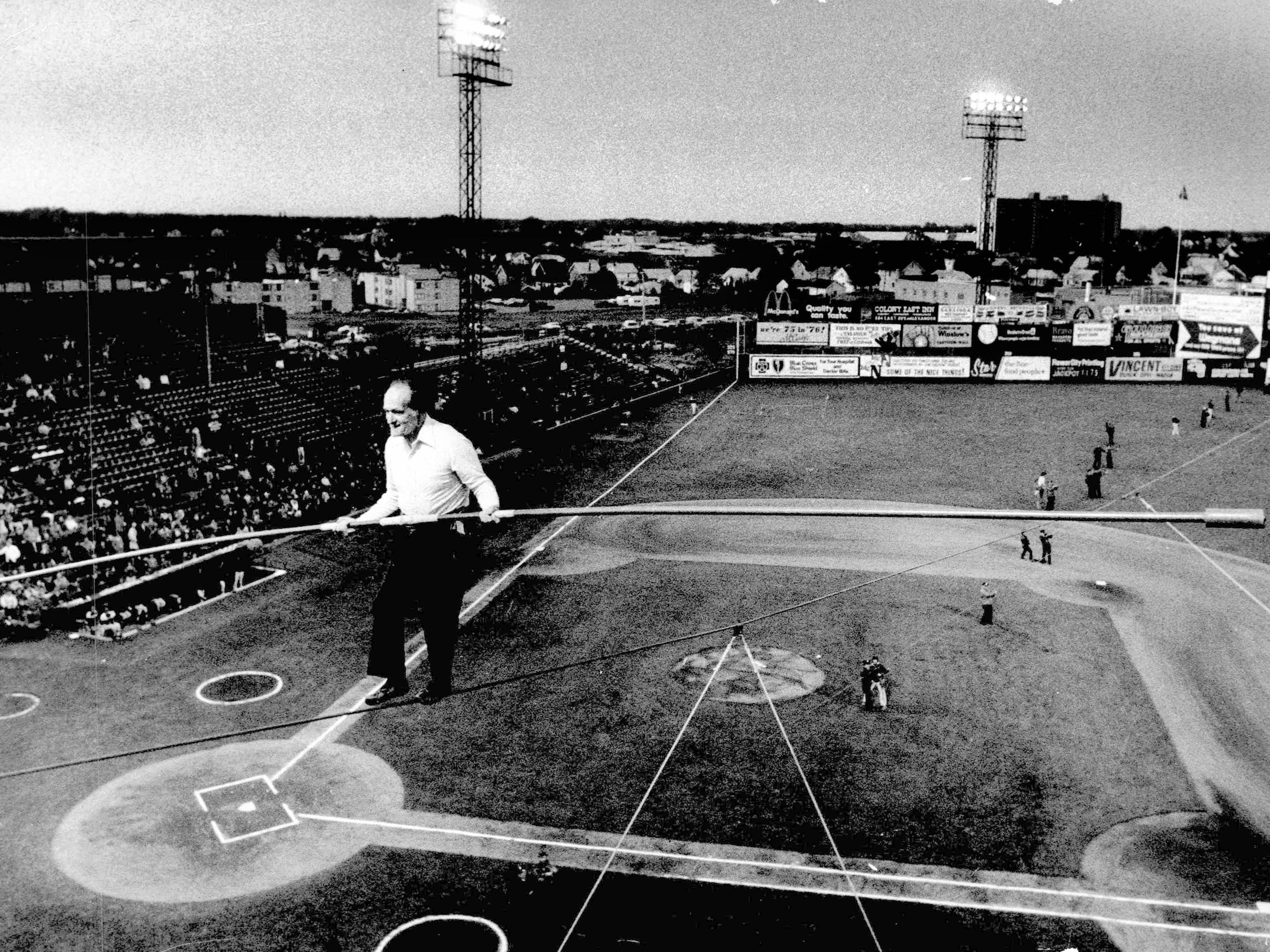 This 1976 photo shows Karl Wallenda walking a tightrope between scoreboard and the roof during doubleheader at Silver Stadium.
