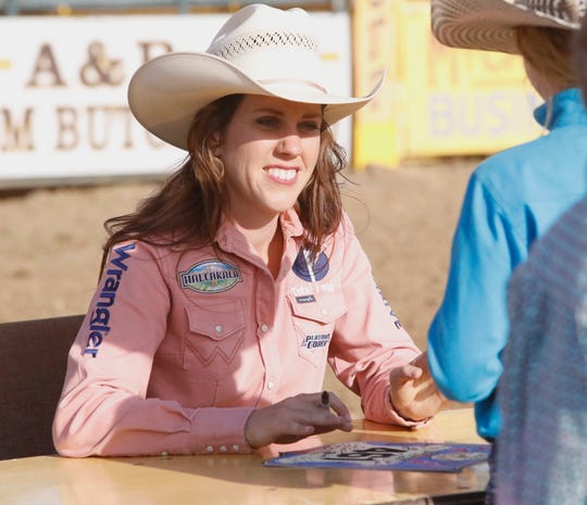 Cottonwood native Nellie Miller signs autographs following the Red Bluff Round-Up on Sunday, April 21, 2019, at the Tehama District Fair grounds. Miller rode her horse Sister to win the rodeo's gold buckle in barrel racing.