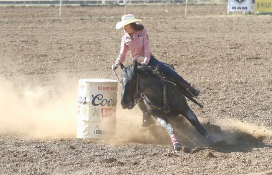 Cottonwood barrel racer Nellie Miller takes a turn on her horse Sister during the Red Bluff Round-Up on Sunday, April 21, 2019. Miller won the barrel racing title with a time of 34.38 seconds on two runs. Miller is ranked first in the Women's Pro Rodeo Association barrel racing standings,.