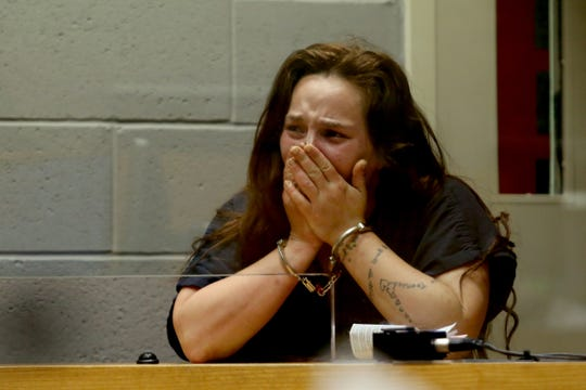 Jessica Pearce, 26, cries while appearing for an arraignment at the Marion County Court Annex in Salem on April 22, 2019. The Stayton woman whose 2-year-old son died in a suspected arson fire was arrested on manslaughter and child neglect charges.