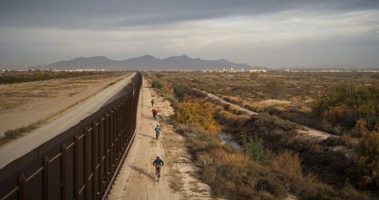 The River and The Wall filmmakers biking beside the U.S.-Mexico border.