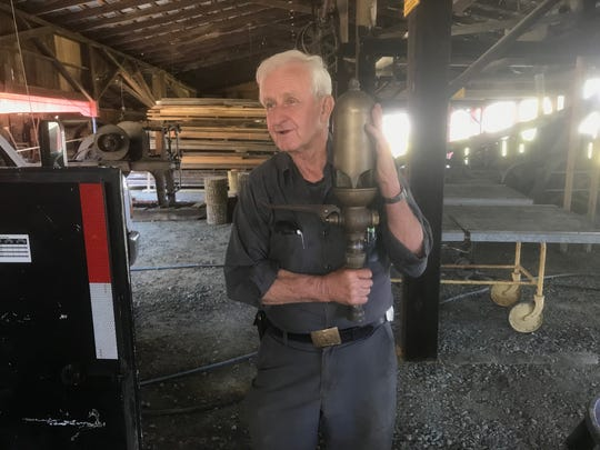 Richard Dryden holds the original brass steam whistle that marked workdays at the 1937 Nassawadox Sawmill in Nassawadox, Virginia on Wednesday, April 17, 2019.