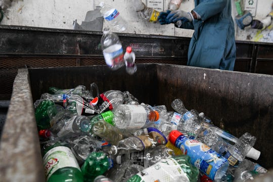 Inmates sort plastic recycling at the Wicomico recycling facility on Tuesday, March 26, 2019. Only plastics numbered one and two can be recycled in the county, because of challenges with the market and contamination, said local officials.