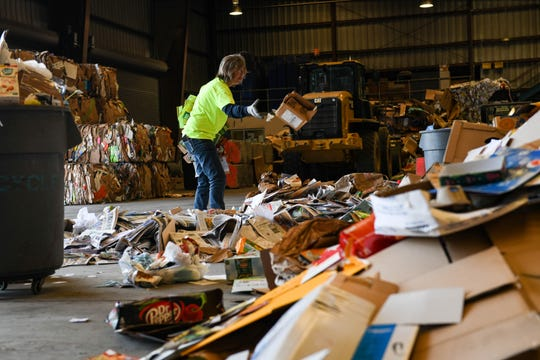 Barb Beebe, transfer station attendant, sorts recycling at the Worcester County Landfill in Snow Hill on Friday, April 19, 2019. The rural county works to keep the recycling rate rising by reaching out get recycling information from local businesses and farms.