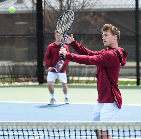 Salisbury University tennis player Andrew Kilchenstein prepares to hit at the SU outdoor tennis courts.