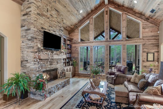 The Colorado-inspired lodge features antique pine ceilings, beams and a stone fireplace.