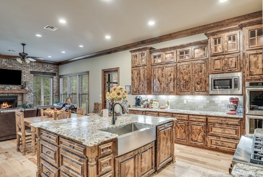 The cook's kitchen has an attached hearth room perfect for family time.