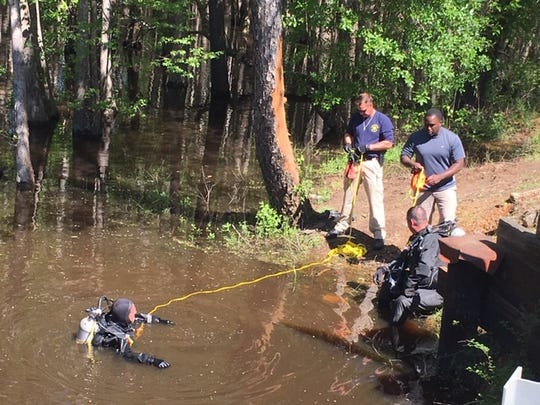 The Sheriff's Office Dive Team was called to recover the body and search for a vehicle on Saturday.
